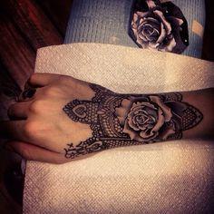 Black lacework & rose tattoo on wrist