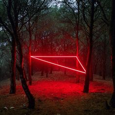 across scenic landscapes in spain, @nicolas_rivals has installed luminous, neon-hued triangles, squares and lines that intersect with the surrounding environment. these shapes engage with the earth, cutting into rocky cliffs, squeezing between the trees, and floating semi-submerged in a sea of water.⠀ ⠀ see more about the #longexposure photography project on #designboom
