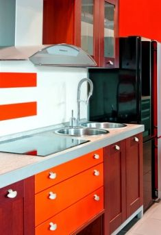 i like the wood and orange two tones not to sure about the style of cabinets
