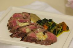Wood-grilled sirloin, topped with house soubise. Plated with sauteed spinach, black trumpets and sweet potato, smear of cashew-coconut purée.