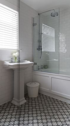 Bathroom basic white subway bathroom with 1 glass side & wood panel around tub idea