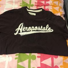 brown Aeropostale shirt in good condition nor tares or stains Aeropostale Tops Tees - Short Sleeve