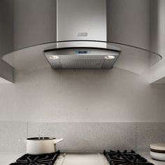 COMO Hood Combines Arched Glass Wings And Stainless Steel To Create A Light  And Airy Environment