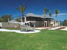 Although located on a private island, the incredible home is far from isolated thanks to the hand helicopter pad and a hangar on site