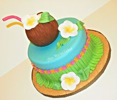 Hawaiian Cake! Coconuts, plumeria blossoms and the grass skirt really make it cool!