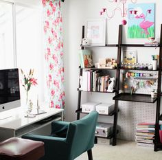 Love those kind of shelves. And the pegboard behind them, awesome.