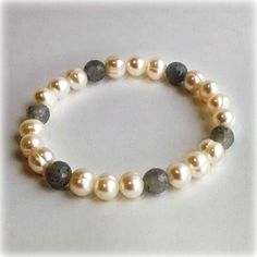 """Honora 7-8 MM White Ringed Freshwater Cultured Pearls With 8 MM Iolite Beads 7.5"""" Stretch Bracelet Ben Garelick is proud to help the SPCA Serving Erie County ra"""