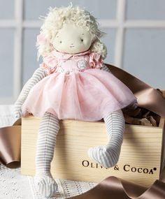 Sweet as can be, Little Miss Caroline is the most polite of tea party pals.  Dressed in a petal pink cotton gown with a soft knit body, yarn hair and stitched facial features, huggably soft Caroline will surely become a favorite dolly. Doll measures 14 tall and comes gift wrapped in a hand crafted wood crate with ribbon.