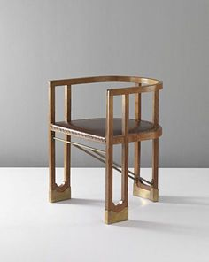 Hans Vollmer. Very rare armchair, ca. 1901. Oak, leather, brass. 27 5/8 in. (70.2 cm.) high. Possibly executed by Prag-Rudniker Korbwarenfabrik, Austria.