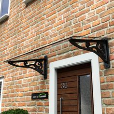Wrought Iron effect scroll door canopy                              …                                                                                                                                                                                 More