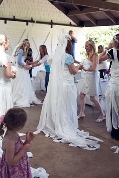 """This games looks fun for a bridal shower! I think its """"who can make the best wedding dress out of toilet paper."""" -"""