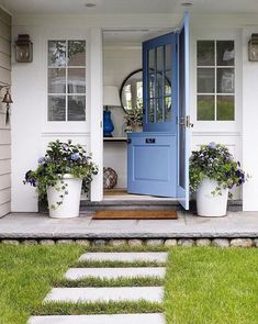 door and stone pavers embody a rural aesthetic . A Dutch door and stone pavers embody a rural aesthetic . Front Door Design, Front Door Decor, Feng Shui, Front Porch Planters, Front Porches, Front Stoop, Front Entry, Vibeke Design, Painted Front Doors