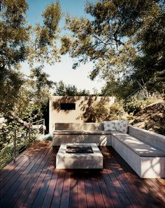 Simple outdoor deck design. I like the barely-visible twisted-wire railings.
