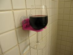 A shower wineglass holder. | 23 Insanely Clever Products You Need In Your Life