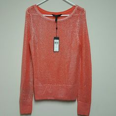 """BCBG MAX AZRIA Absolutely gorgeous! ! NWT Exellent Mint condition!  Top quality,  amazing fabric. It comes with full tags and an extra thread kit. Color is """"Ambrosia """"  similar to a coral shade with silver woven through. Pair this versatile sweater with your favorite white pants or shorts for a bright look, or match with your favorite pattern or jeans! Bundle it to Save even more! Reasonable offers will be accepted.  on merc as well BCBGMaxAzria Tops Blouses"""