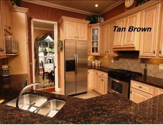 Tan brown countertops with light cabinets