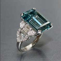 12.16 carat emerald cut aquamarine ring with baguette, bullet shaped and round diamonds set in platinum.
