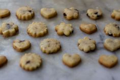Adapted from a Susan Herrmann Loomis recipe - charming, snappy, salty-sweet olive-flecked shortbread deliciousness. Quirky yet sophisticated, they exist in some middle Earth realm between cracker and cookie
