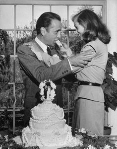 Bogart/Bacall Wedding Actress Lauren Bacall feeding cake to husband Humphrey Bogart at their wedding at Louis Bromfield's farm. In May 21, 1945.