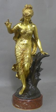 Antique dore and patina over bronze figural sculpture of a beautiful young woman on red marble base. Statue En Bronze, Bronze Sculpture, Sculpture Art, Sculpture Ideas, Metal Sculptures, Abstract Sculpture, Art Nouveau, Sword Drawing, Art Deco Buildings