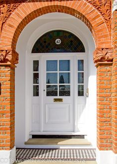 Stunning Large Edwardian front door with arched top door frame. All painted white set within a beautiful red brick arch. Arched Front Door, Victorian Front Doors, Front Door Porch, Front Doors With Windows, Wooden Front Doors, Front Door Entrance, Arched Doors, House Front Door, White Front Doors