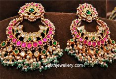Lotus earrings with chandbali pattern and guttapusalu hangings with kundans and barmese stones and green stone highlights .<br>Lotus design in chandbali is attractive.<br>To order 01 December 2017 Indian Jewelry Earrings, Jewelry Design Earrings, Indian Wedding Jewelry, Gold Earrings Designs, Gold Jewellery Design, Bridal Jewelry, Gold Jewelry, Antique Jewellery, India Jewelry