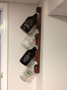 Storage rack for beer growlers. My boyfriend would love this. Definitely a good birthday present for a beer lover!: