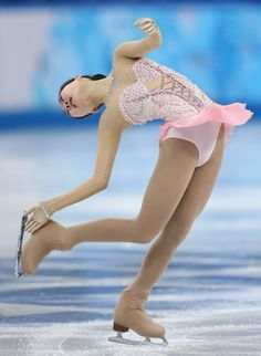 Zijun Li Photos Photos - Zijun Li of China competes in the Figure Skating Ladies' Free Skating on day 13 of the Sochi 2014 Winter Olympics at Iceberg Skating Palace on February 20, 2014 in Sochi, Russia. - Winter Olympics: Figure Skating