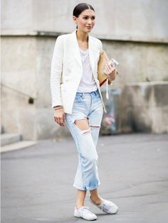 Wear a white t-shirt with a white blazer, distressed boyfriend jeans, white sneakers, and slick hair