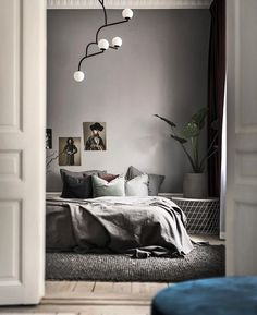 gray moody bedroom with modern lighting