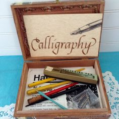Calligraphy Kit - Writing Kit - 10 Nibs - Calligraphy lettering instruction booklet - Pen collector - Penmanship - Wood Cigar Box - feathers by TheWhatNaught on Etsy