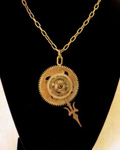 Steampunk Clock Gear Necklace by CodachromeCreations on Etsy  Handmade item Cost: $35 usd Length: 20 - 28 inck inches Materials: Vintage clock parts, Screws and nuts, Jump rings Ships worldwide from Thousand Oaks, California