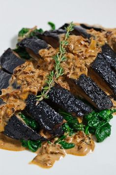 Grilled Portobello Mushroom in a Porcini Cream Sauce on a bed of Spinach