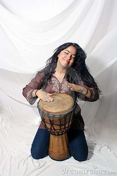 The joy on her face is a projection of why we play hand drums... although, I have yet to play my djembe on my knees...