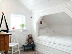 Built-in bed under eaves.