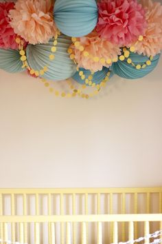 pom poms and paper lanterns. (polka dot garland from paint chips makes it that much more whimsical!)