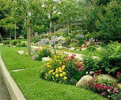 curved flower bed along side/back walkway..like.