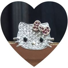 925 Hello Kitty CZ ring SANRIO Hello Kitty ring size 4. Sterling Silver ring and CZ. With yellow gold plated nose and bow. All intact and perfect!!!! I worn this ring like 3 times, like new condition!!!  Slightly scuffed on bottom band from being worn. Sanrio Jewelry Rings