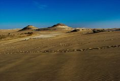 Round mountains near Bir Wahed (well and spring water) and fossil area, Siwa, Great Sand sea, Western Desert, Egypt