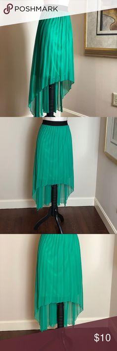 "RENN Green shark bite lined skirt Elasticized waistband. Pleated filmy fabric over a lining. Measures about 12"" across the waistband lying flat. Renn Skirts Asymmetrical"