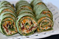 Ingredients       4 large spinach or regular tortillas burrito size   8 ounces of cream cheese softened   1 cup of shredded cheddar cheese   1 teaspoon of chili powder or more to taste   1 cup of canned black