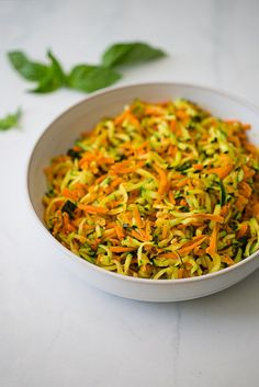 Zucchini and Carrot Hash, an easy and healthy vegetable side dish! Dial back the amount of oil the recipe calls for!