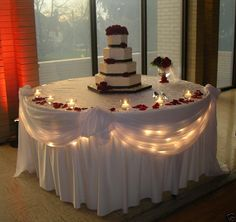 Simple. I would do little candles around the cake with pink rose peddles. | so romantic, I loved it :)