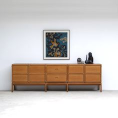 Solid and well build Belgium modern high sideboard. Outside look 4 door cabinet with in the middle 4 drawers. Inside plenty of storage place. The cabinet is in a good condition, massive and very large.