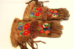 These wonderful gauntlets have had lots of wear, but there are no holes, and the beadwork and fringe are fully intact. Antique Native American Beaded Leather Gauntlets Gloves - First Nations.
