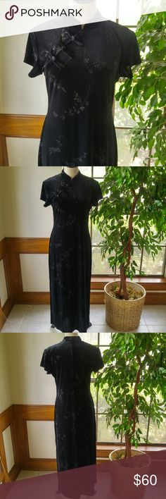 Asian Inspired Full Length Dress This beautiful black dress from Dress barn has a high collar and an asymetrical, off center button detail and side slit. Leaves and butterflies in silver adorn the dress. In perfect like new condition. Worn once. Dress Barn Dresses