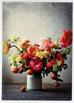 Add your favorite seasonal flower to the invitations and place cards,