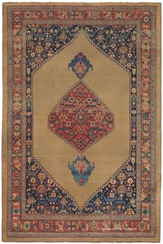 This 19th century Bijar Camelhair antique rug is a standout among the incredibly rare subgroup of room size antique carpets employing fields of undyed camelhair. It combines a sophisticated palette, extremely generous spacing and purposeful asymmetry to create an enrapturing impact. Its deep rose medallion is flanked by alluringly graceful azure pendants amidst a veritable sea of rich camelhair. In exceptional condition at very significant