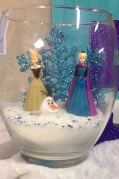 Elsa scene I used a glass, the Elsa and Anna figurines, the snowflake, and some Epsom salts all from dollar tree!