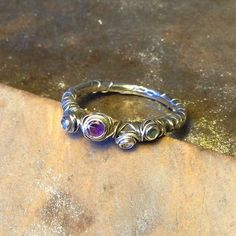 Ethically handmade recycled silver ring. Set with amethyst, aquamarine and CZ. £150
